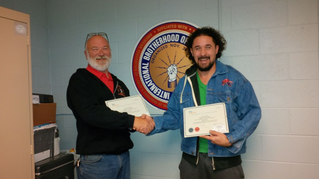 Greg Hennessey receives his Red Seal from IBEW 993 Business Manager, Glen Hilton