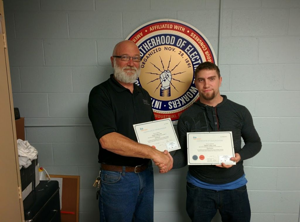 Dan Lucas receiving his Red Seal from Business Manager, Glen Hilton