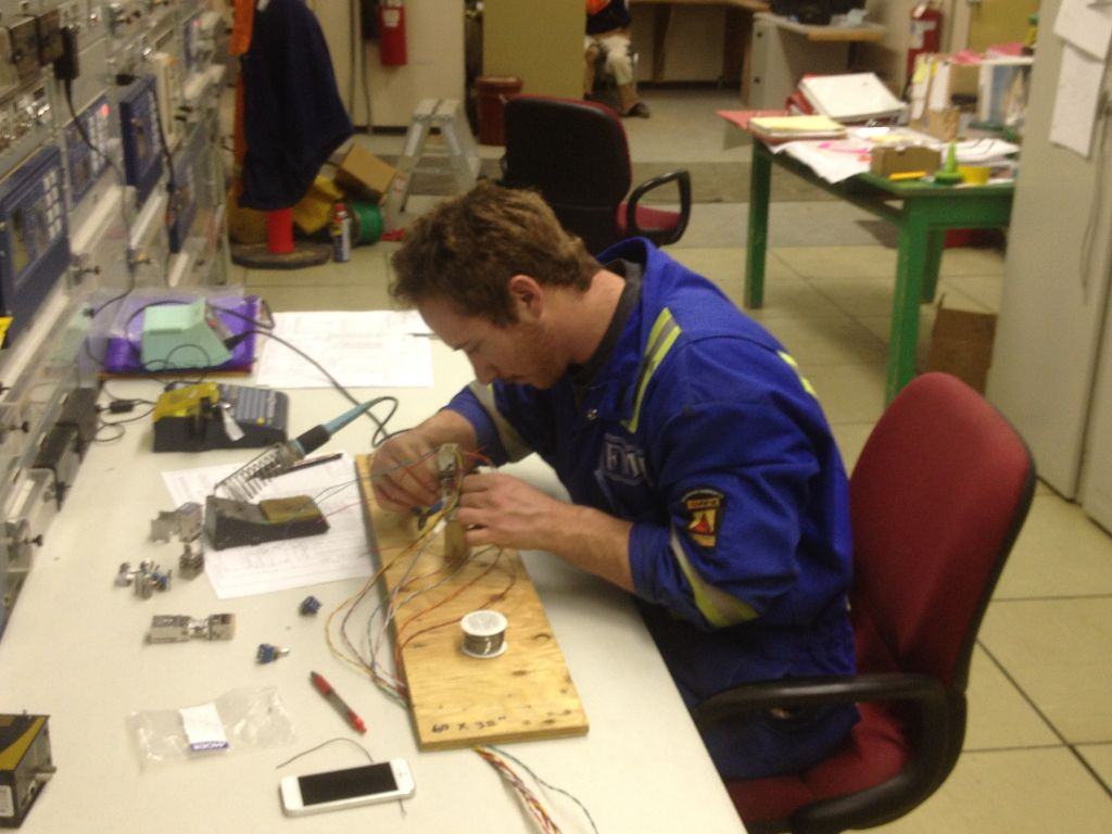Tyler Murphy working in Dawson Creek soldering in the control building.