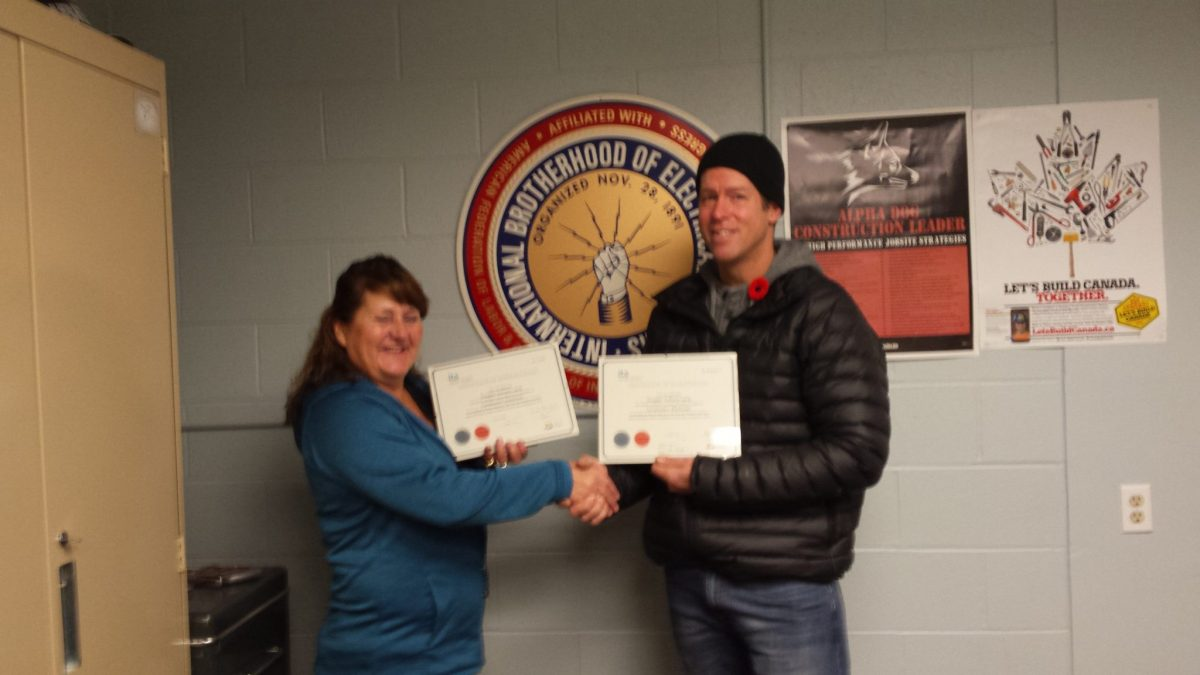 Joann Steele presenting Douglas Laing with his Red Seal